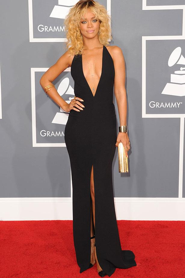 At the 2012 Grammys – keeping things simple in a Giorgio Armani LBD with an extreme plunging neckline and a flash of thigh.