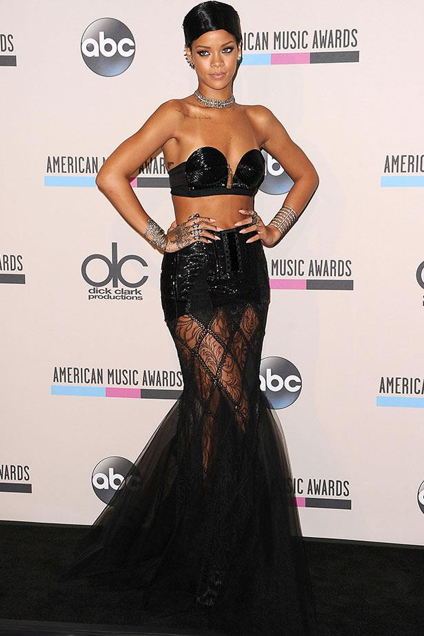 In a sequinned bra top and sheer skirt at the 2013 American Music Awards.