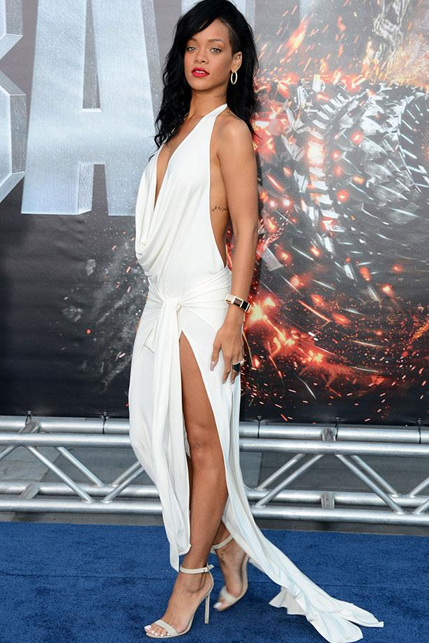 Again opting for minimal thigh coverage and maximal plunge, yet still managing to look ethereal in white at the 2012 premiere of Battleship.