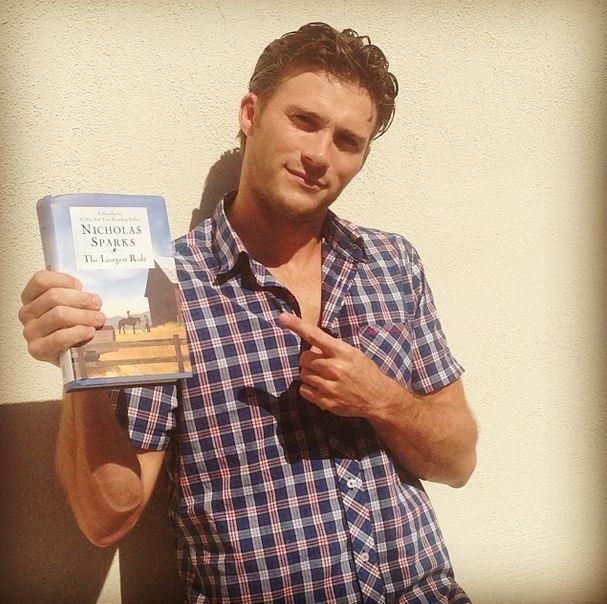 "We love a man who reads. Scott Eastwood poses with the novel of the film adaption he's set to star in, <em>The Longest Ride</em>, by Nicolas Sparks. ""Great book. Thanks Fox for this amazing opportunity!! #thelongestride #nicholassparks,"" he said."
