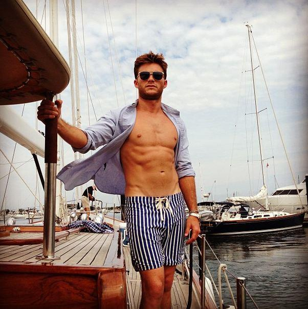 More shirtless posing by Scott Eastwood - this time he's on the set of a shoot for <em>Town & Country</em>. He came in first in their Top 50 Bachelor list, cementing him as a sex symbol-to-watch.
