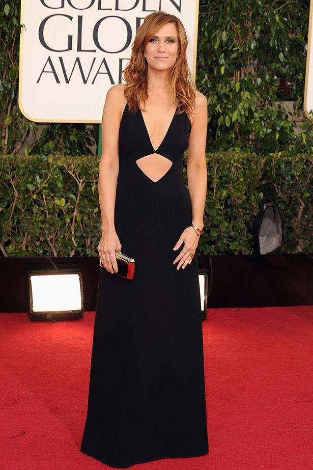 Kristen Wiig wearing a black keyhole gown by Michael Kors at the 2013 Golden Globe Awards.