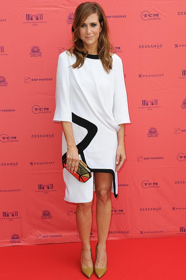 At the Paris premiere of <em>Imogene</em>, Wiig looked incredible and effortless in this white dress by Prabal Gurung.