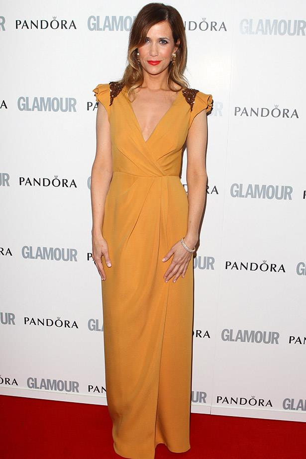 As most women know, it's not easy to pull off mustard, yet Kristen Wiig seems to do it with ease, pairing this J. Mendel gown with a bold red lip and vintage-inspired curls.