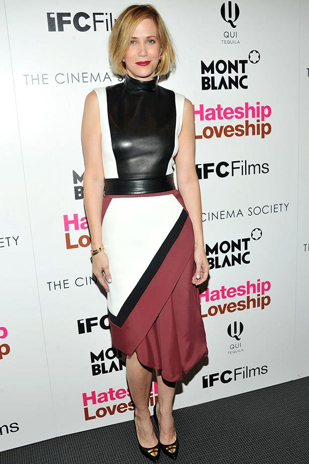 Again in J. Mendel, Wiig wore this leather/wrap skirt look to the New York screening of <em>Hateship Loveship</em> earlier this year.