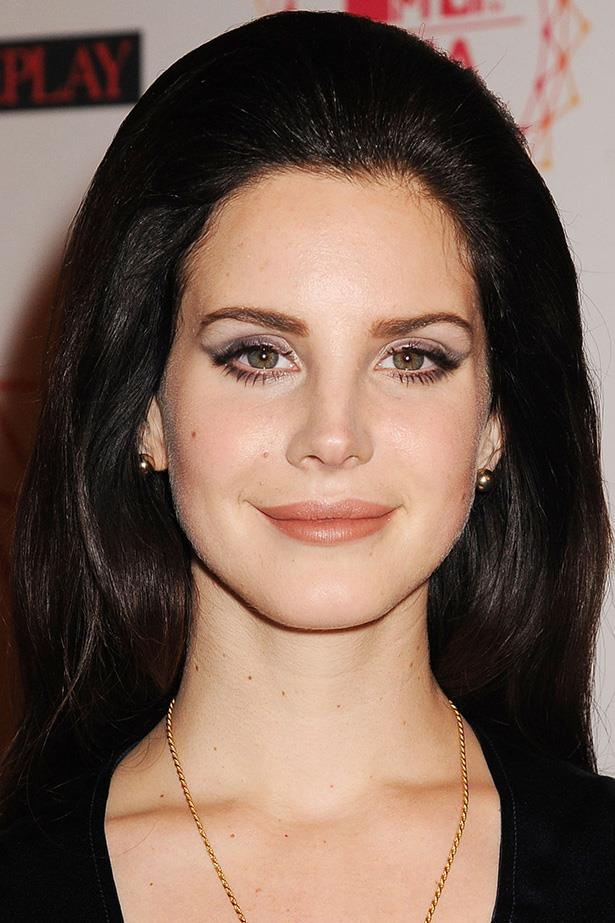 Del Rey pairs voluminous bottom lashes with a fresh take on the 60's bouffant at the MTV EMA's in Germany.