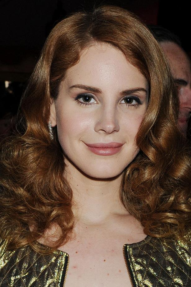 A younger Del Rey shows off her lighter hair in bouncy ringlets at the 2012 Grammy Awards.