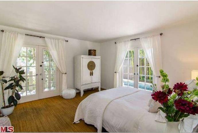 One of the three bedrooms features French doors which open up to the patio and lap pool.