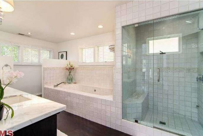 The second bathroom boasts another delicious-looking tub and luxurious shower.