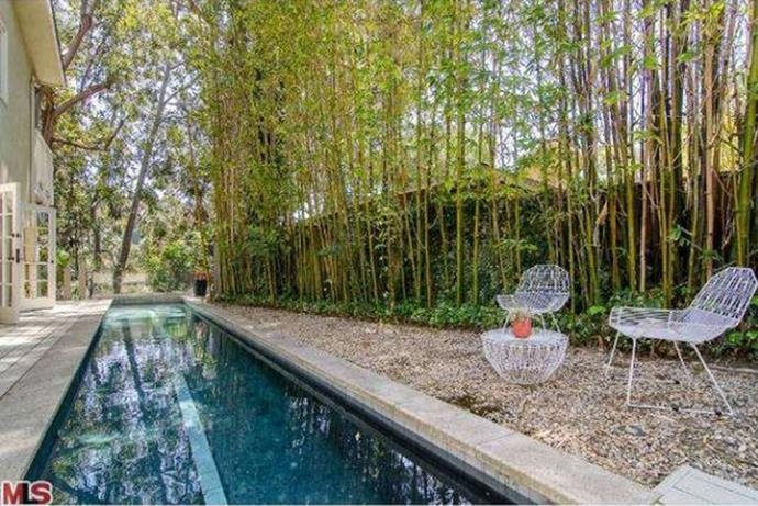 The outdoor area, completely with paparazzi-proof bamboo-lined fences, features a chic lap pool.