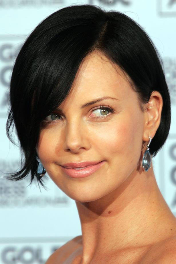 Cropped jet black hair emphasised Theron's green eyes at the 62nd Annual Golden Globe Awards.