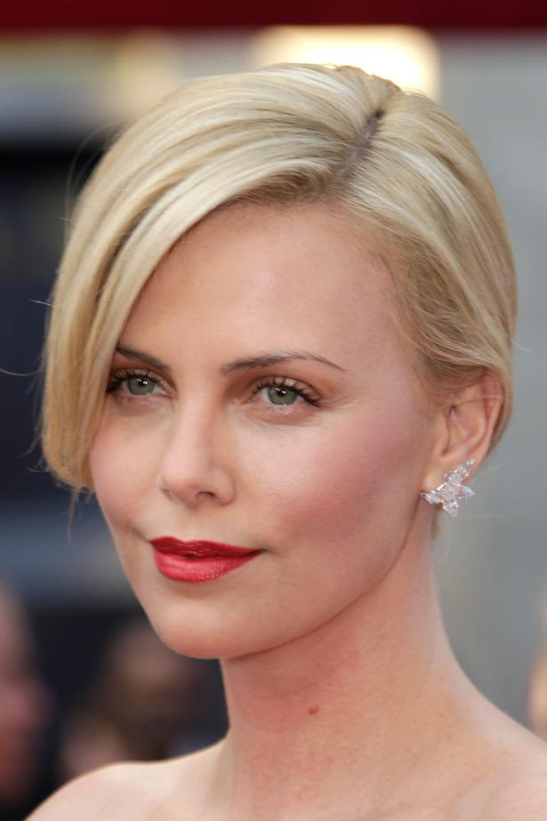 On the red carpet in 2010 Theron complemented a bright raspberry lip with cool blonde hair.