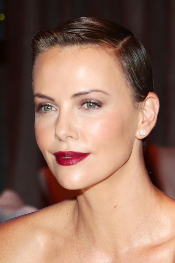 No stranger going brunette for films, Charlize shows her recently chopped locks in 2013.
