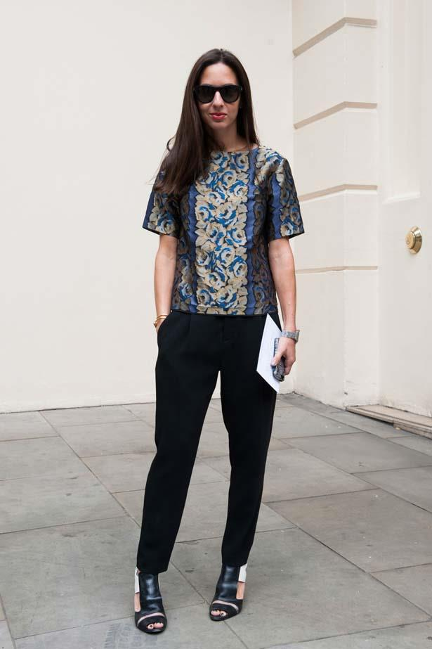 A failsafe pair of black pants teamed with a floral top.