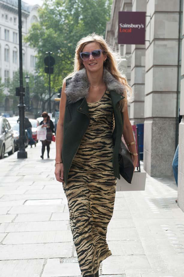 A fur collar and tiger print dress will ensure all eyes are focused on this fashion week attendee.