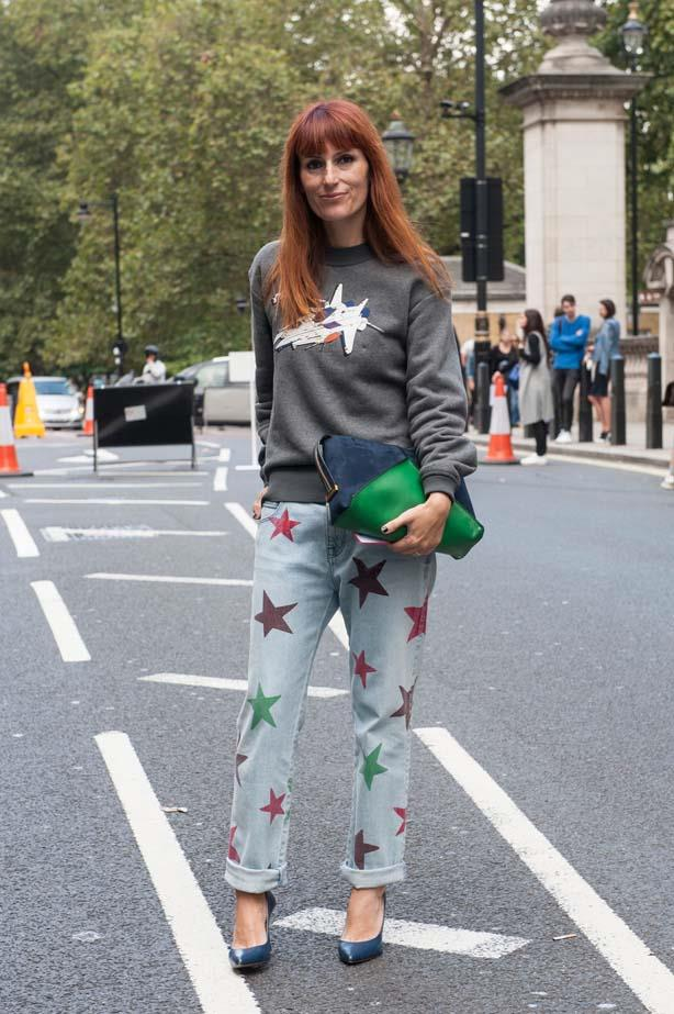 Printed jeans and a motif sweater make for a stylish yet comfortable fashion week outfit.