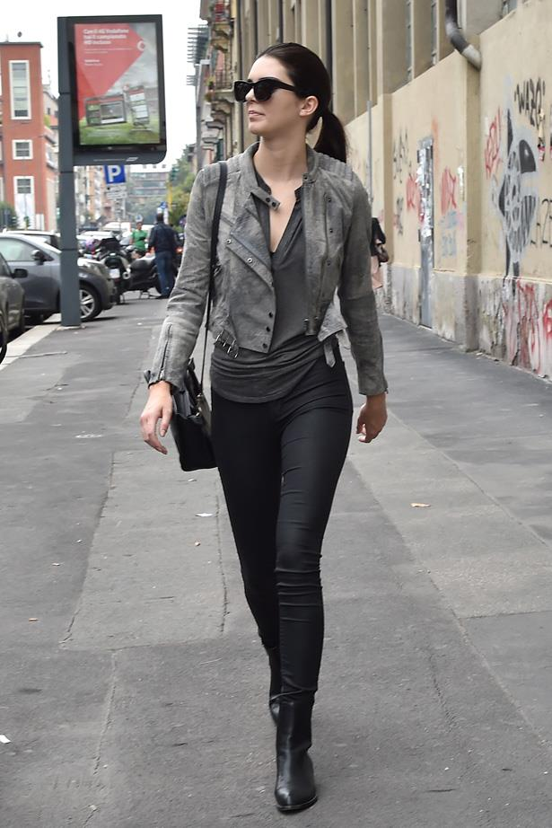Seen out and about between shows in Milan, Kendall kills it in a simple (but typical model-like) skinny jeans, leather jacket and Alexander Wang boots.