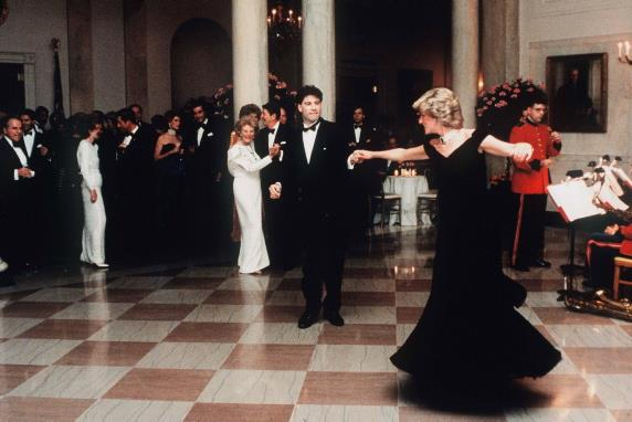 A Victor Edelstein dress, worn by Princess Diana for a dinner at the White House in 1985 when she famously danced with John Travolta, is up for auction.
