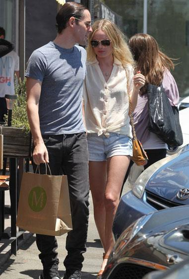Kate Bosworth spent a day out in Los Angeles with her boyfriend, director Michael Polish, wearing Topshop shorts and a Tom Ford bag.