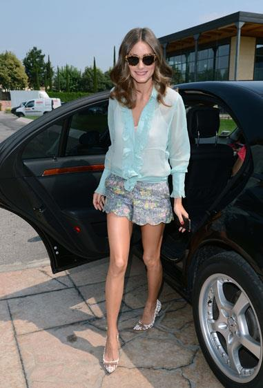 Olivia Palermo wore an Intimissimi blouse and high-waisted shorts ensemble at the Intimissimi fashion show in Verona, Italy.