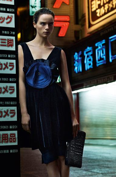 Anna De Riik in a futuristic Tokyo setting, shot by Alasdair Mc Lellan for Emporio Armani's A/W 12-13 campaign.