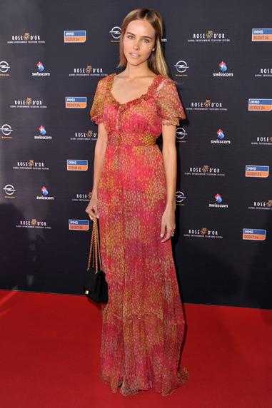 Isabel Lucas stays true to her hippie style in a printed Collette Dinnigan dress at the Rose d'Or Television Festival in Switzerland
