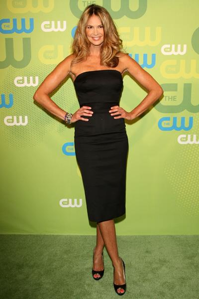 Elle Macpherson began her love-affair with Victoria Beckham designs at the CW Network Upfront party in 2009.
