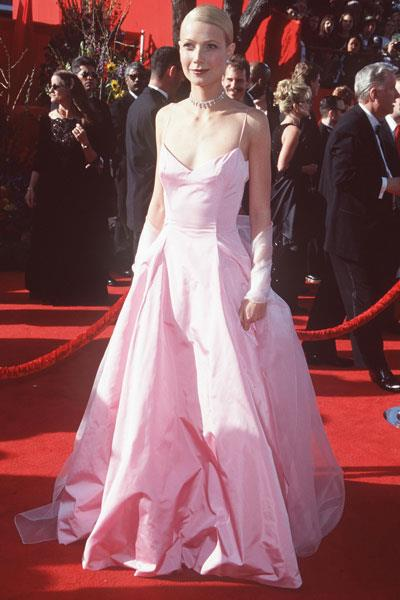 Paltrow steps onto the Academy Awards red carpet in a pink Ralph Lauren ball gown. The look received mixed reviews until she earned the Best Actress Oscar for her role in Shakespeare in Love.