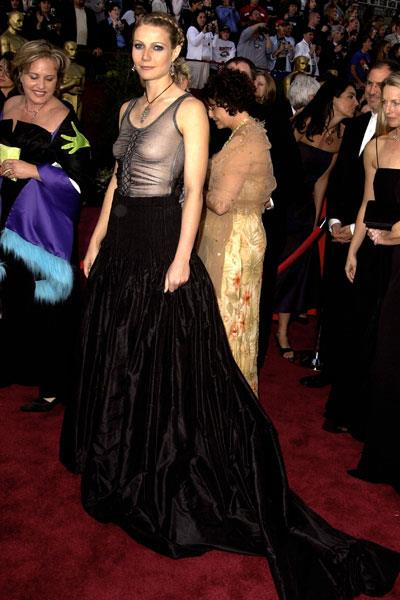 Paltrow receives scathing reviews for her Alexander McQueen Oscars dress in 2002 but later remarked that is was one of her favourite red carpet dresses