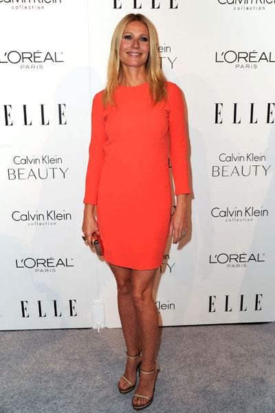 Paltrow goes for bold orange Calvin Klein at a fashion week party in 2011