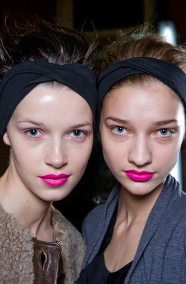 Pretty in pink: Whether punchy and bright or sultry and washed-out, a pink lip is the perfect finish to the new season beauty look. Spurred on at Jil Sander - where Peter Phillips created an eye-catching rose-hue that was full of pigment - and later in more subdued forms at Cacharel, Carven and Haider Ackermann, both the colour and the finish (powdery-matte was the weapon of choice) were decidedly graphic, not retro. Pictured: Clements Ribeiro A/W 2012-2013