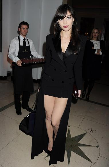 Daisy Lowe flashes some leg in a tuxedo short suit.