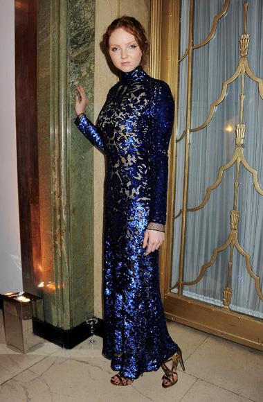 Lily Cole wore a floor-length beaded sheath in a rich sapphire blue.