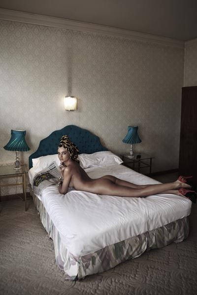 Miranda Kerr wears towel, stylist's own; Dolce & Gabbana shoes, $925, from David Jones; Cartier earrings (worn throughout), $4450; on her left hand: Bulgari ring, $26,800; Delfina Delettrez cuff, $6529; on her right hand: Bulgari ring, $13,950; Delfina Delettrez cuff, $7550. Styled by Jillian Davison.
