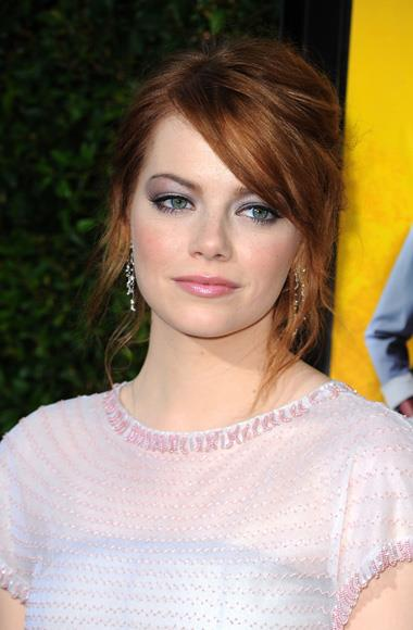 Emma Stone with pastel-hued statement eyes at the premiere of The Help.