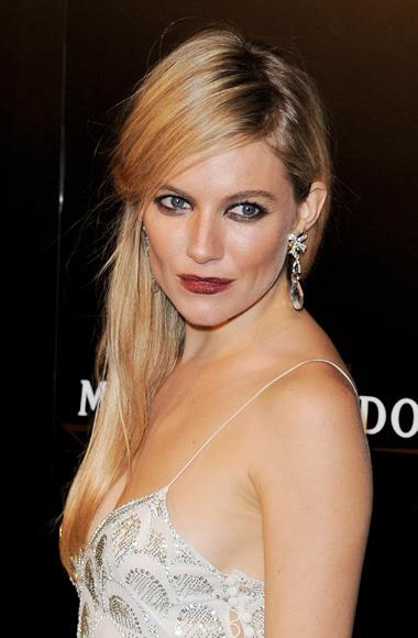 Sienna Miller at the Moet et Chandon party for Mario Testino during London Fashion Week.