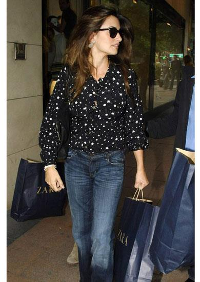 Penelope Cruz in a Dolce & Gabbana A/W 11-12 star print blouse paired with jeans