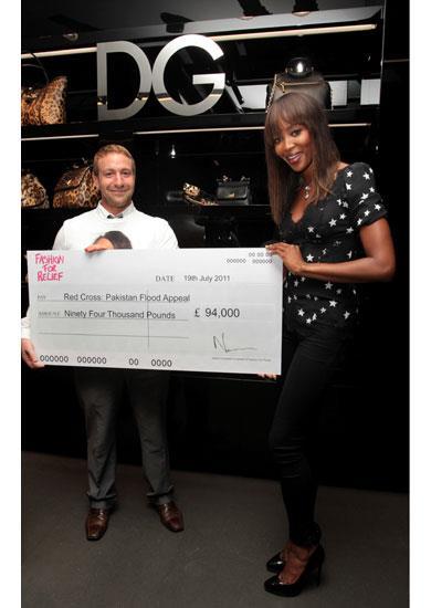 Naomi Campbell presents an award wearing a Dolce & Gabbana A/W 11-12 star blouse