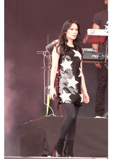 Lucy Lui performs in a sequined star dress by Dolce & Gabbana A/W 11-12