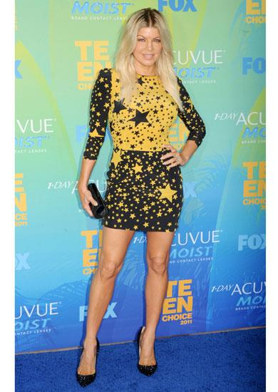 Fergie arrives on the red carpet wearing a star print dress from the Dolce & Gabbana A/W 11-12 collection