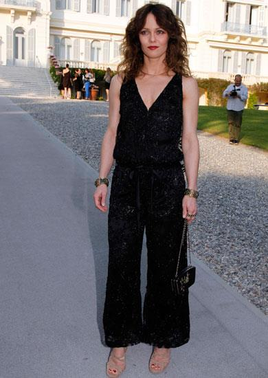 Vanessa Paradis attends the Chanel Collection Cruise Show wearing a Chanel jumpsuit.