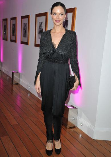 Marchesa designer Georgina Chapman wears her own design at the Elle And Dior party during Cannes.