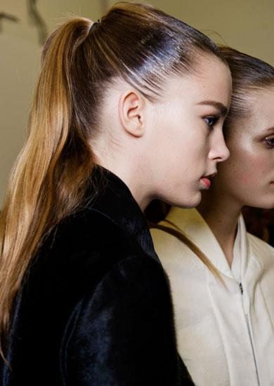 "9. STICK TO WHAT SUITS. Love the ponytail trend? Then choose a style that suits your bone structure. So what height is the most flattering? ""Work with the lines of your cheekbone or jawline, following either to a point on the back of your head to get the most flattering place to secure a ponytail,"" advises L'Oréal Professionnel stylist Malcolm Edwards. Pictured: Backstage at Calvin Klein Collection A/W 11-12."