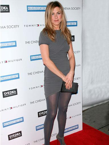 In a grey bandage dress at a Cinema Society screening in L.A