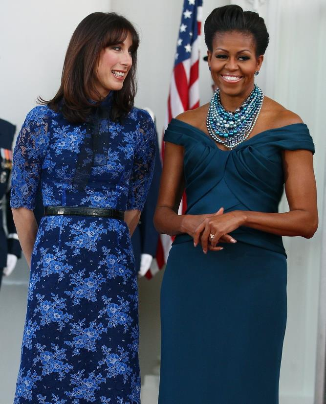 <u><b>In your 40s...</b></u><br> Michelle Obama, 49, First Lady of Style<br> The glamorous Ms O (right) scores sartorial points for the chic royal blue Marchesa dress worked back with fabulously layered Tom Binns necklace.  A chic cocktail ring and earrings complete the look.