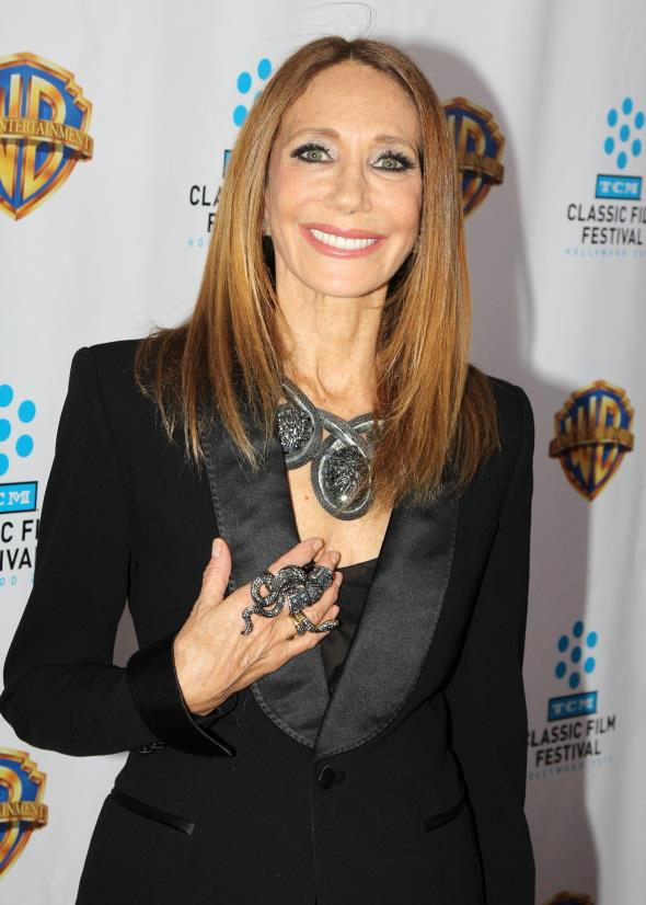 <u><b>In your 60s…</u><br> Marisa Berenson, 66, Model</b><br> Taking python to a whole new level on the red carpet in New York is fashion icon Marisa Berenson working bold statement neckpiece and slithering ring.