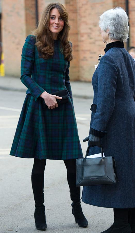 In a green tartan skirt and jacket paired with heeled boots while visiting St. Andrew's School on November 30, 2012 in Pangbourne, England.