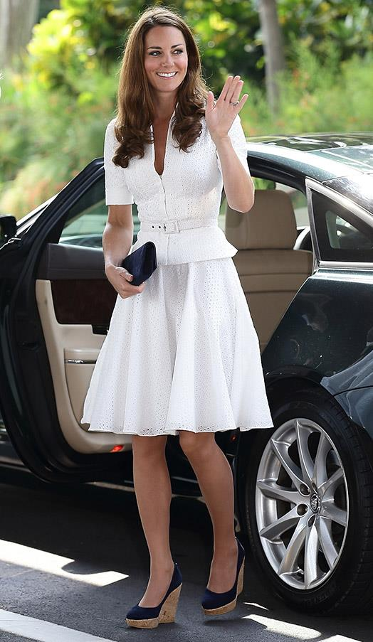 In a belted white skirt and top on Day 2 of the Diamond Jubilee Tour of South East Asia on September 13, 2012 in Kuala Lumpur, Malaysia.