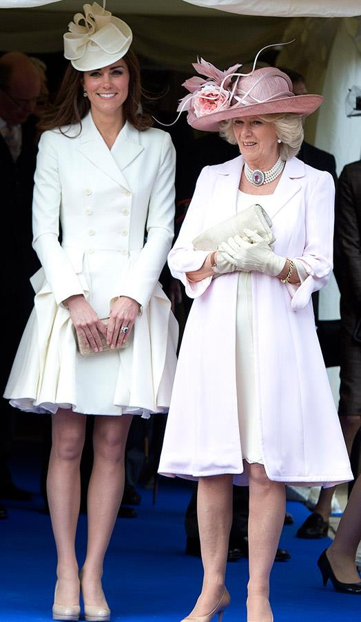 In a pleated ivory dress with  Camilla, Duchess of Cornwall at the Order of the Garter on June 18, 2012 in Berkshire, England.