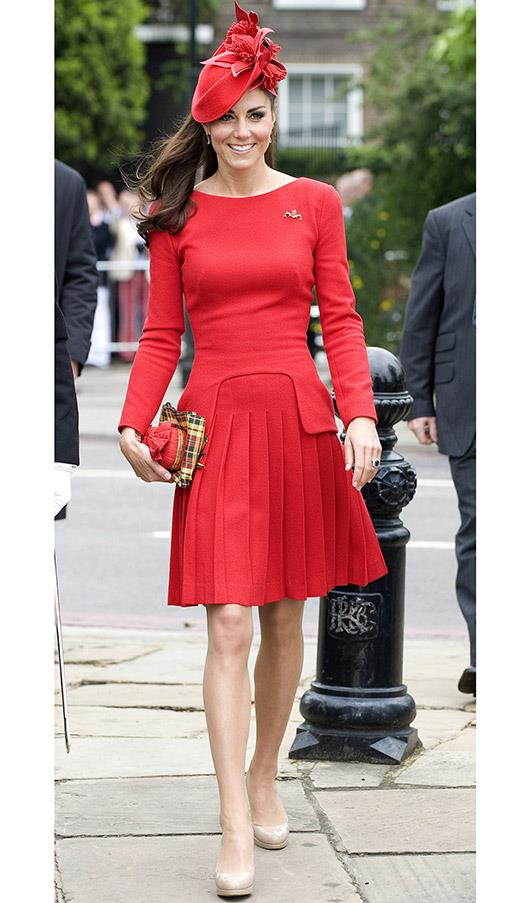 In a red pleated skirt and long-sleeved top during the Thames Diamond Jubilee Pageant on June 3, 2012 in London, England.